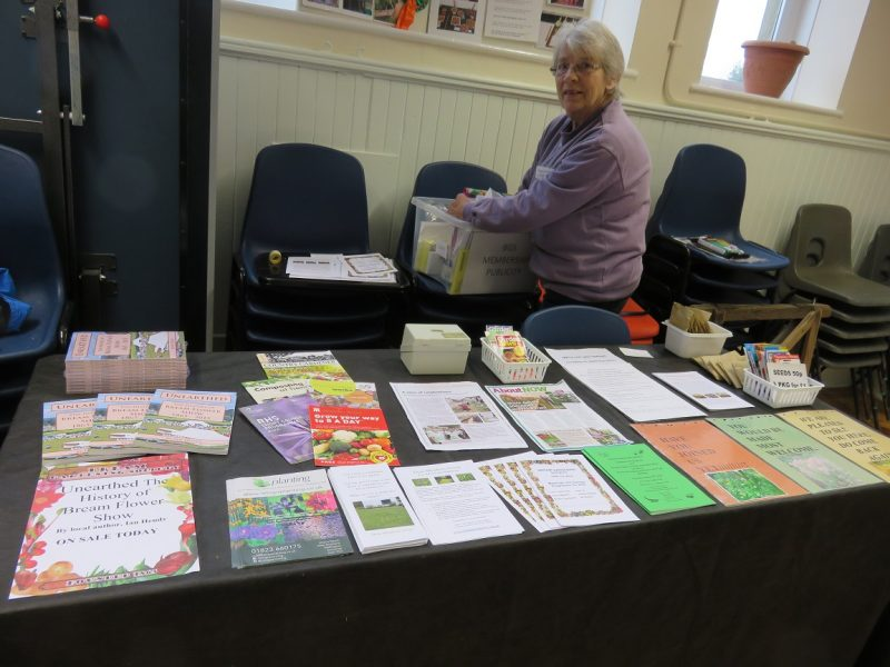 A photo of Membership Secretary, Maggie Stewart, getting a table ready for show visitors.