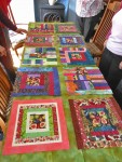 A photo of ome of the squares laid out for the anniversary quilt
